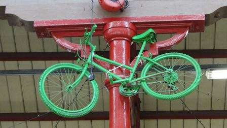 Green painted bicycles have been hung from every corner of South Molton Country Pannier Market and t