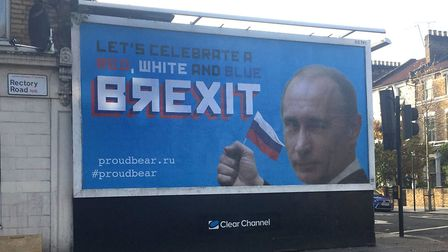 A billboard featuring Russian leader Vladamir Putin in north London after an anonymous group of acti