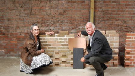 Museum manager Alison Mills and Councillor Dick Jones get to grips with the new bricks for the £2m e