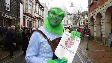 The Grinch with Santa's naughty list at Great Torrington's Christmas 'Who-billation' on Saturday. Pi