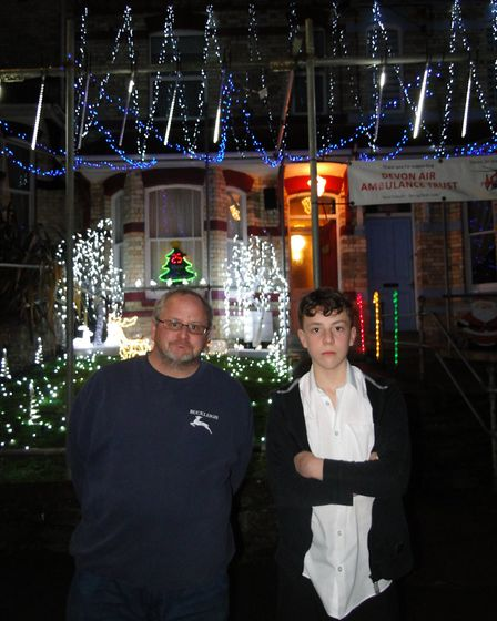 Mark and Josh Chorlton outside their house in Lime Grove, Bideford. Picture: Sarah Howells