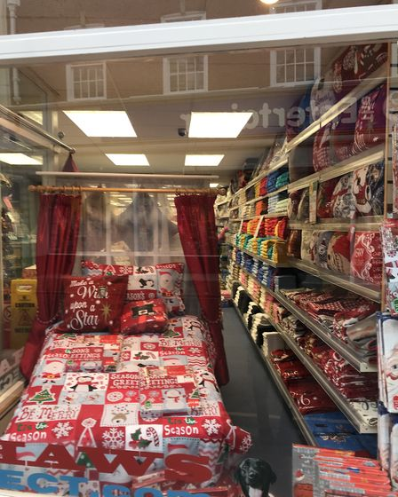 Shaws the Drapers has a very festive bedroom in their window.