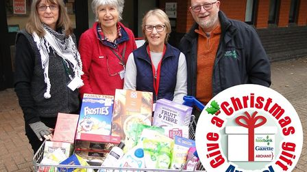 Volunteers from the Northern Devon Foodbank are ready to hand out Christmas treats to family in need