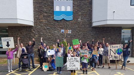 The climate change protest outside Riverbank House on Friday, May 24.