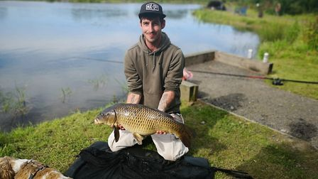 Adam Young with a common carp from the new Karen's Lake at Bideford Angling Club's Tarka Swims compl