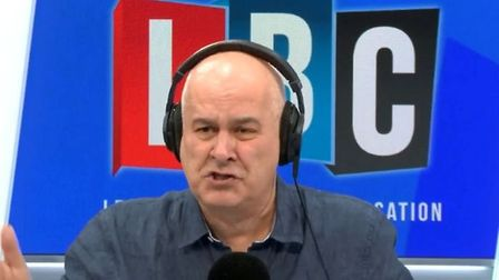 Iain Dale answers calls from listeners. Photograph: LBC.