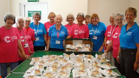 Volunteers from the Braunton branch of Cancer Research UK with the fruits of their labours for the b