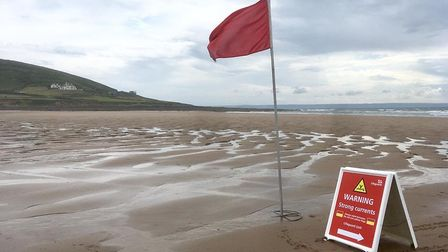 Warning signs on Croyde beach. Picture: Matthew Whitley/RNLI