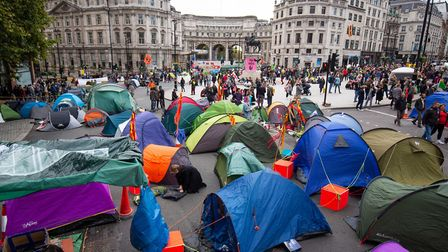 Tents erected by protesters during an Extinction Rebellion (XR) climate change protest in Trafalgar
