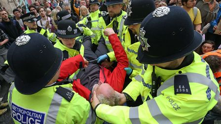 Police arrest a protester at Millbank near to the junction with Great College Street, during an Exti