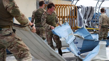Members of the Humanitarian and Disaster Relief (HADR) team from RFA Mounts Bay, aid assistance to i