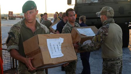 Personnel from RFA Mounts Bay delivering aid to the Island of Great Abaco in the Bahamas. Picture: R