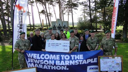 Presenting the proceeds of the Jewson Barnstaple Marathon 2019 at RMB Chivenor and revealing the dat