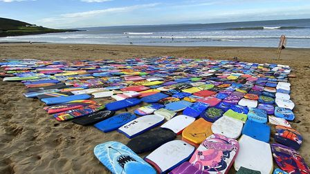 480 abandoned bodyboards were placed on the beach at Croyde Bay. Picture: Matt Smart
