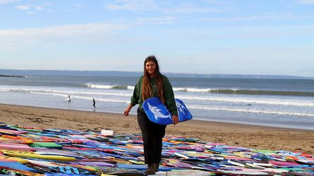 Croyde Bay beach ranger Holly Robertson with the abandoned bodyboards. Picture: Matt Smart