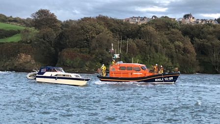 The motor cruiser being towed by Ilfracombe RNLI's all-weather lifeboat. Picture: Mark Gammon