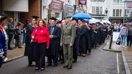 Students and dignitaries parade through Barnstaple High Street for the Petroc graduation 2019. Pictu