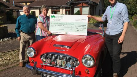 Diane and Bob Harrison present their fundraising cheque to CHSW community fundraising assistant Nevi