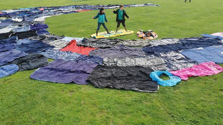 Children creating the art installation made from discarded inflatables left behind in Croyde in just