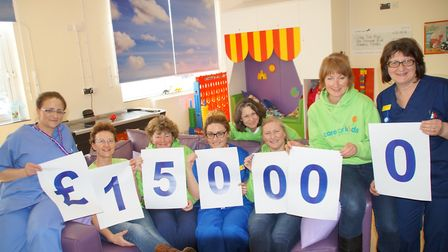 Care for Kids volunteers and Caroline Thorpe ward staff celebrate reaching the £150,000 fundraising