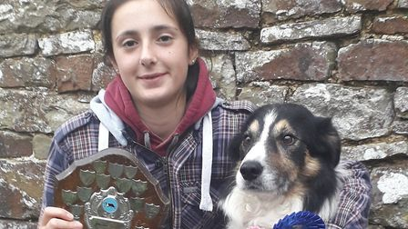 Mary Lucas-Ridge with her best friend Mac after they scored their best sheep dog trials result at tw