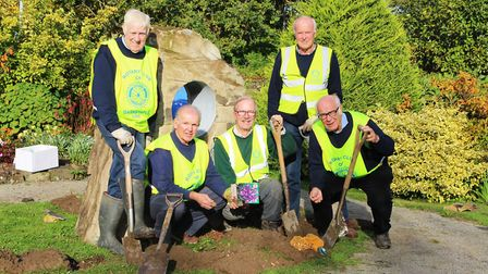 Rotarians called in at North Devon Hospice to plant crocuses for World Polio Day.