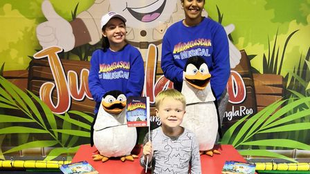 The penguins from Madagascar the Musical pictured with Ernie, aged four. Picture: BoomBoom Media