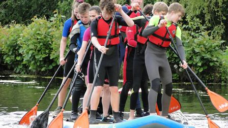 North Devon Taw Explorer Scouts try out the new paddleboards purchased thanks to generous local gran