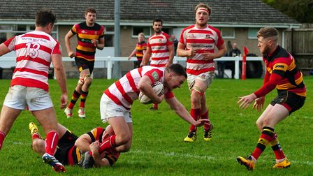 A great tackle brings Bideford's Freddie Fishleigh to the ground. Picture: Kevin Crowl