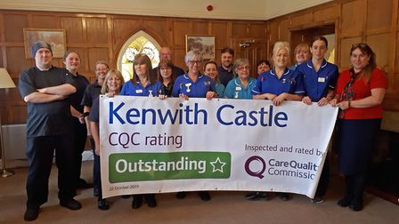 Kenwith Castle staff celebrating their 'outstanding' rating.