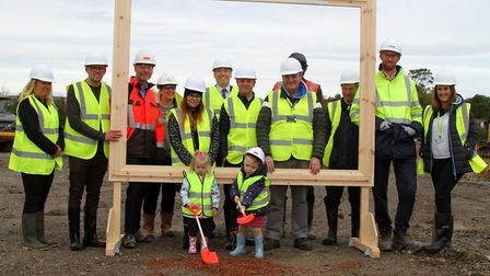Future pupils Matilda Su Green and Francesca Ley helped break the ground of the new Roundswell Commu