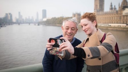 A woman takes a selfie with then speaker of the Commons, John Bercow, on Westminster Bridge in Londo