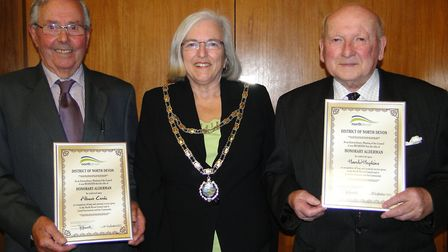 Aldermen Albert Cook (right) and Harold Hopkins receiving their certificates from North Devon Counci