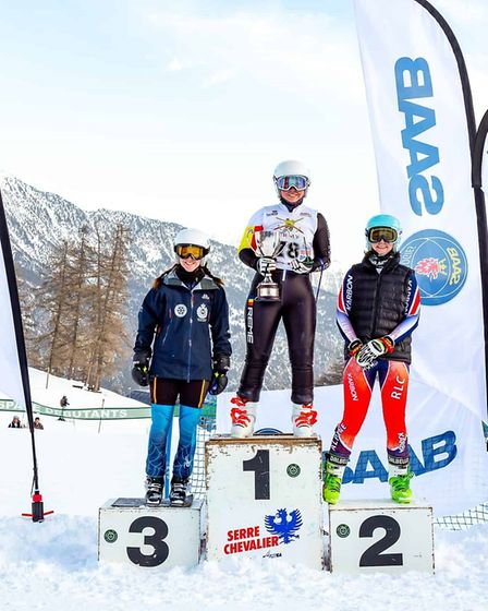 Holly Lake on the podium after winning the British Army Ski Championships giant slalom competition.