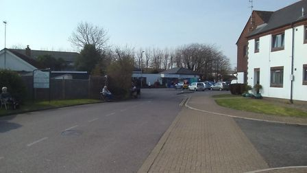 The huge queue to the Lloyds Pharmacy at Caen Street Medical Centre in Braunton, with customers spac