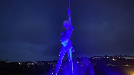 Damien Hirst's Verity in Ilfracombe is lit up in blue in honour of the NHS. Picture: Tony Gussin