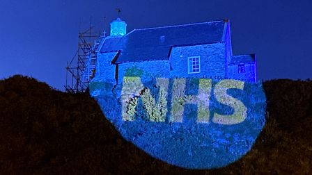 St Nicholas Chapel on Lantern Hill in Ilfracombe is lit up blue in honour of the NHS. Picture: Tony