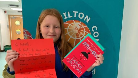 Isabelle Bolton with her note and books from author Sarah Crossan. Picture: Pilton Community College