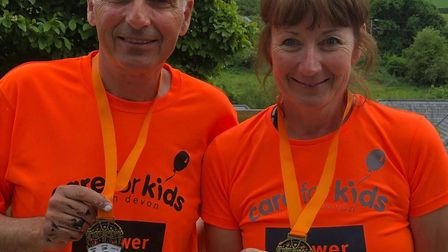 Theo and Jacky Massos, charity manager, sporting Care for Kids virtual 10k medals.