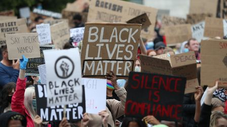 People participate in a Black Lives Matter protest rally outside the Guildhall in Southampton, in me