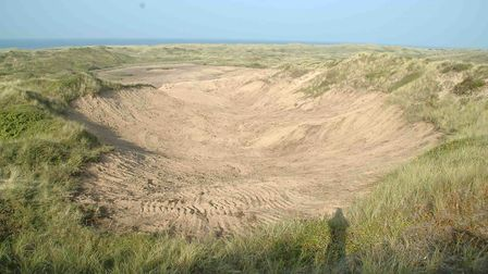 Creation of bare sand by scraping scrub from Old Met dune slack, Picture: Rupert Hawley