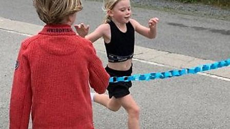 Beth Conroy, aged eight, has completed 3.7 miles each day for Northern Devon Foodbank in her marath