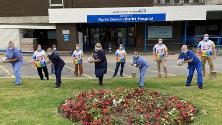 Staff at North Devon District Hospital with the rainbow rugby balls and shirts created by Aramis Rug
