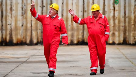 Prime Minister Boris Johnson walks in the dry dock with caretaker Clifford Edwards during his visit