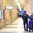 ALERT IN VIENNA: Armed police control a passage near the opera in central Vienna following a shooting near a synagogue.