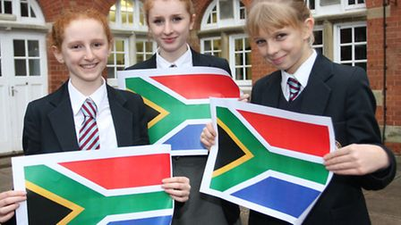 Rosie Varley,Helana Varley and Flora Willis-Fleming with their South African flags as they will be v