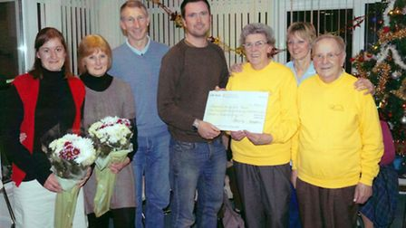 Doug Millar and his uncle Rob present a cheque to Living With Cancer's Pat and Eddie Cannings and Ly