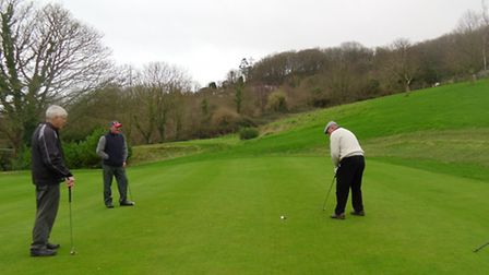 Moray Bosence holes out for a birdie after a great approach shot to the eighteenth - 1137. Malcolm W