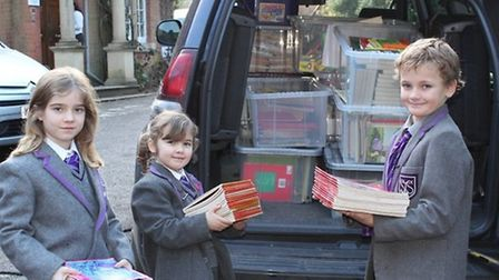 Juniors at St John's giving books to Book-Cycle