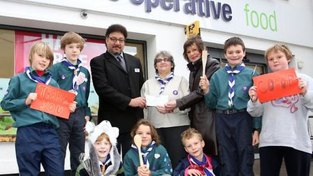 Co-Op store manager Mick Alphonse and Christina Gittins hand over a cheque for £1000.00 to Nancy Cra